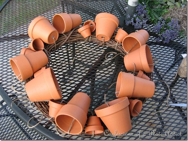 "Flower pot wreath: start with five 3""pots, then five 2.5"", fill in with ten 1.5"" pots. Fill with foam, moss, flowers. See site for details."