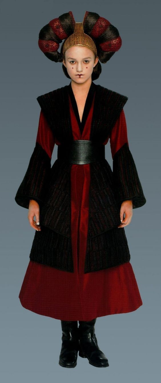 Sabé, Padmé Amidala's handmaiden, in the formal version of Padmé's battle dress, being a decoy to protect her queen in Star Wars: Episode I - The Phantom Menace.