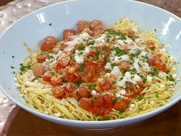 Spaghetti with Tomatoes, Hot Dogs and Parsley recipe from Emeril Lagasse via Food Network