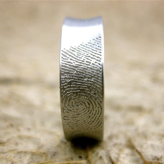 Such a unique idea! An engraving of your wife's fingerprint on your wedding band. I would even say, it could be really nice to do matching bands with each others fingerprints.