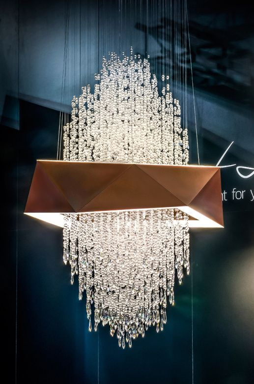 Lighting Bracelet - a cloth screen the colour of copper. Instead of a hand, we put the bracelet on a curtain made from cut crystal beads. Design by Martin Lukačka