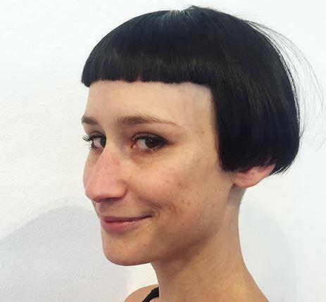 boxbob haircut with an undercut and short straight bangs