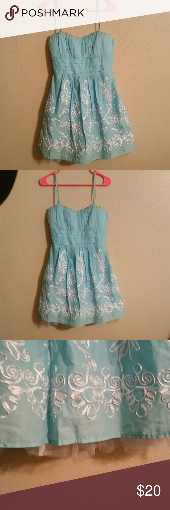 Light blue summer spaghetti strap dress. This dress is perfect for a semi casual summer o spring wedding. Dress it with cow boy boots, flats or dress it up with wedges! Has tule underneath for a little extra cuteness. B. Smart Dresses Mini