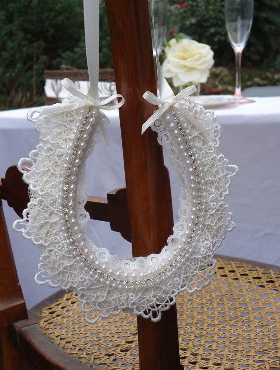 Personalized handmade vintage style lace, pearl and diamante bridal horseshoe gift or wedding decoration.. £20.00, via Etsy.