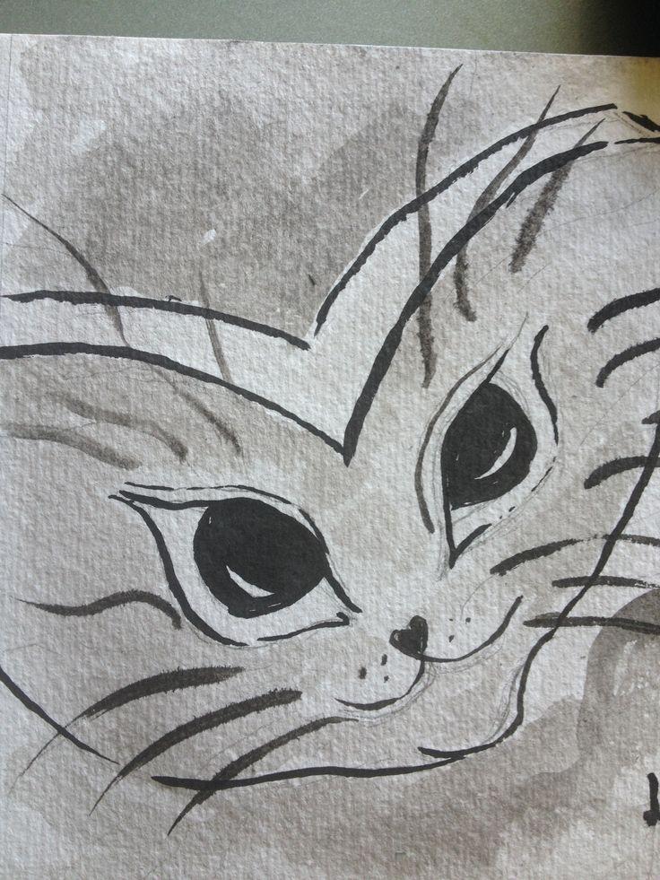 Katt tegnet med pensel og blekk