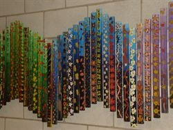 interesting kids group craft idea - paint sticks (paint stirrers?) and hang together for a larger piece