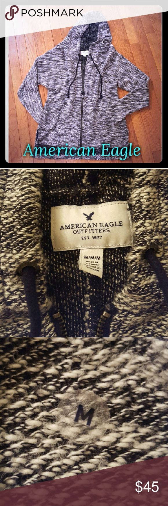 NWOT American Eagle Sweater Jacket NWOT.  Never washed or worn.  Still has size sticker on it.  Comes down a little lower in back, perfect to wear with leggings or whatever you want.  So soft and cozy!  Black/white size medium American Eagle Outfitters Jackets & Coats