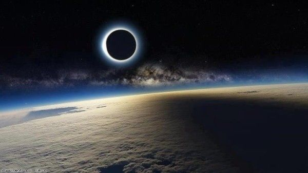 Eclipse in space! Not sure if this is Photoshopped or the real deal. Hope it's real because it's super cool!