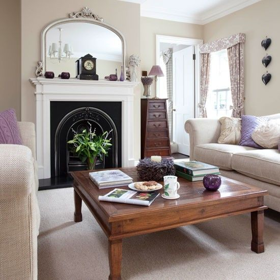 Neutral living room with cast iron fireplace