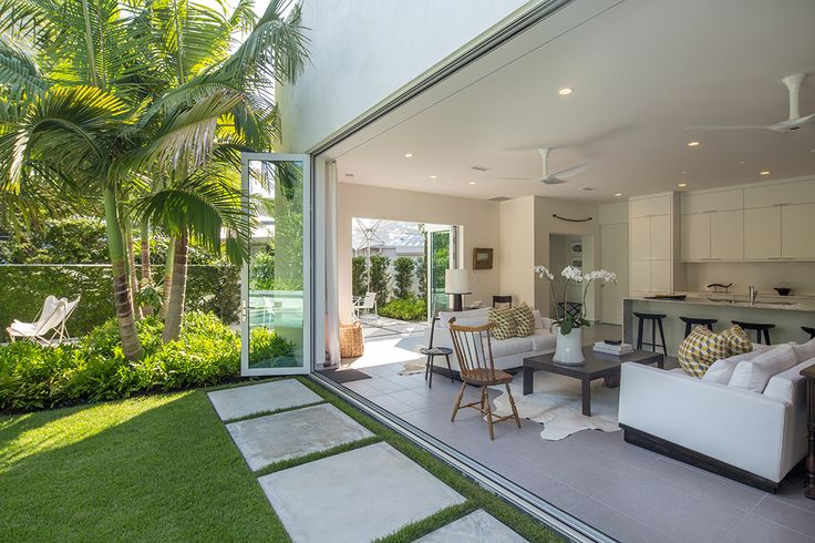 Indoor/outdoor living is what it's all about in the heart of Key West. The concrete pavers were specifically used in keeping with this modern home, planting was kept to a minimal groupings but still adding a lush tropical element to the house that helps to soften the solid, modern structure.