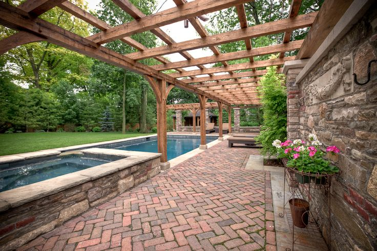This beautiful hand hued oak arbor supported by stone walling dotted with carving inlays is a perfect compliment to your outdoor pool.