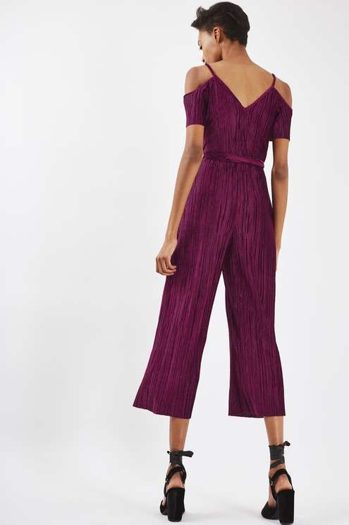 Mix up your party wardrobe with this cool wide leg jumpsuit in a crinkled fabric. With the forever-trending cold shoulder detail, it also comes with a tie at the waist for a flattering fit. In a cropped length, it's perfect teaming with heeled sandals for an elevated look. #Topshop