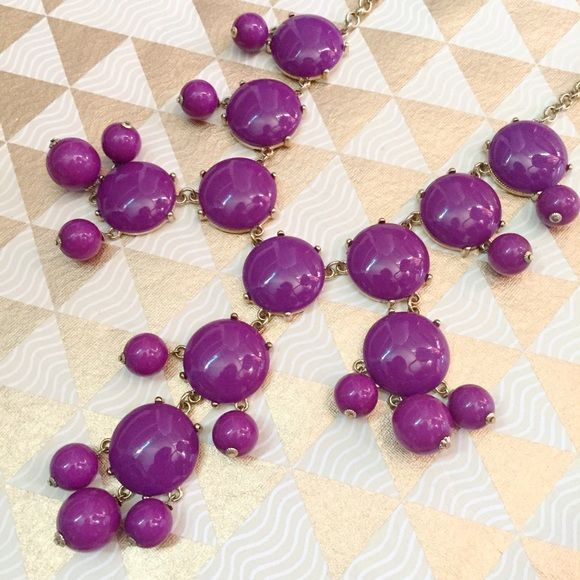 Purple Bubble Necklace Fun purple bubble necklace will add some pizazz to any outfit! This style is reminiscent of the bubble necklace popularized by J. crew Jewelry Necklaces