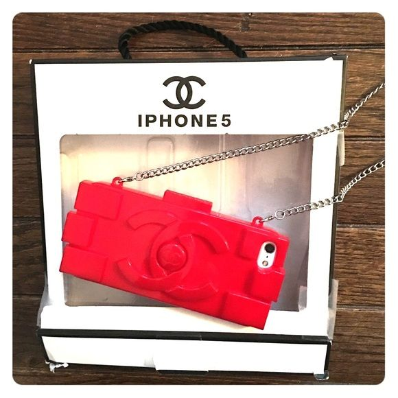 Chanel iPhone 5 case Chanel red Lego design iPhone 5 or 5s case with box (torn a little). I got this at a resale boutique and it was marked as authentic. Comes with long chain for a Chanel-purse like look that is removeable. Case is flexible and covers small amount of front of phone to prevent any screen cracking. This case is my all time fav sad to see it go but got phone upgraded CHANEL Accessories Phone Cases