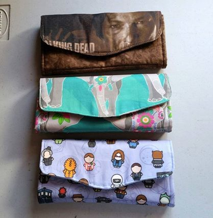 Clutch Wallets inside ~ zippered compartment, CC slots, 2 divider panels & 2 non zippered compartments  see next photo for inside view :)    Email: mbmaccessories1@gmail.com Facebook: https://www.facebook.com/mbmaccessories1