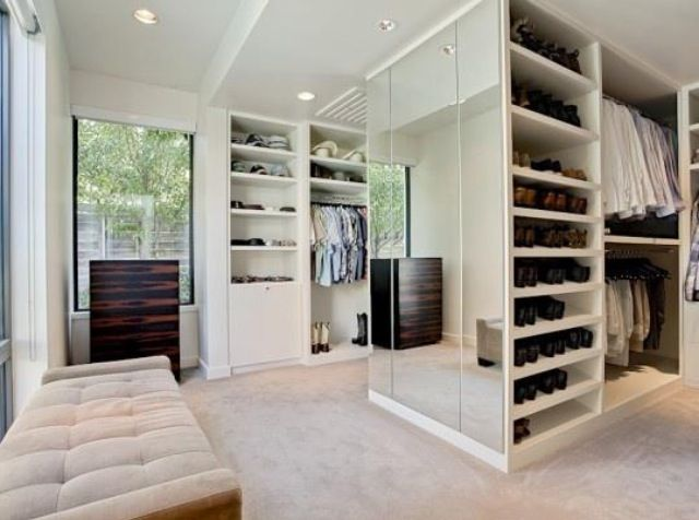 Luxury Closet with upper and lower hanging space, shoe storage and mirrored wall