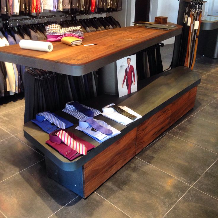 This custom built display table for Burrows Clothiers in Oakville features walnut drawers and top sitting on a hot rolled steel frame finished with a low gloss clear coat.