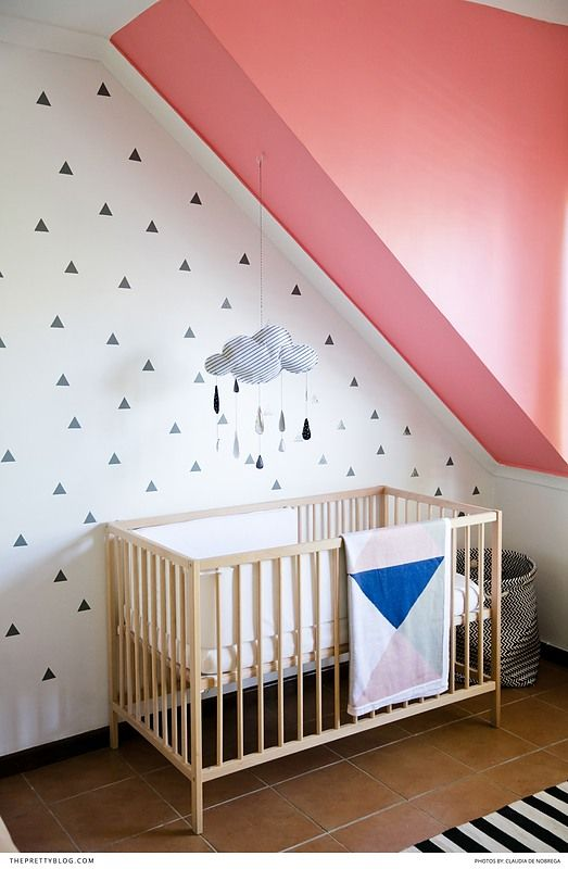 Beautiful baby nursery with geometric patterns on the wall and pink accents! https://www.theprettyblog.com/family/a-trendy-nursery-for-this-familys-memorable-moments/?utm_campaign=coschedule&utm_source=pinterest&utm_medium=The%20Pretty%20Blog&utm_content=A%20Trendy%20Nursery%20for%20This%20Family%27s%20Memorable%20Moments