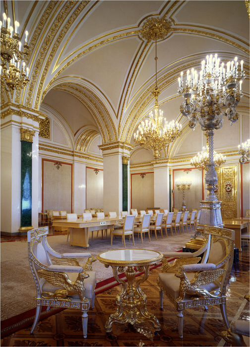 It's the Catherine's Hall of the Grand Kremlin Palace, the outstanding place where the citizens of Russia are awarded by the leader of the state. The Hall is named in the honor of the only female Order of Imperial Russia, that was St. Catherine's Order founded by Peter The Great in 1713. The famous golden gates through which the President of Russia enters the hall (these gates are known from TV news) are to right. The detailed image of these gates is in this board.