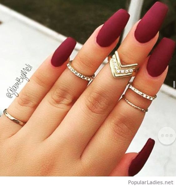 long-burgundy-nails-with-gold-rings-and-diamonds