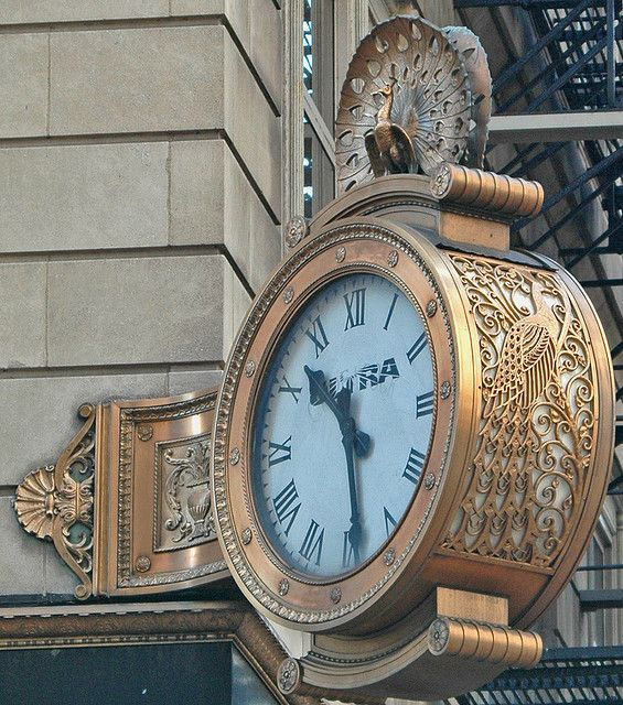 Peacock Clock -  Ornamental clock with peacock motif on the site of the former Peacock's Jewelry Store at State and Monroe Streets in Chicago, Illinois.
