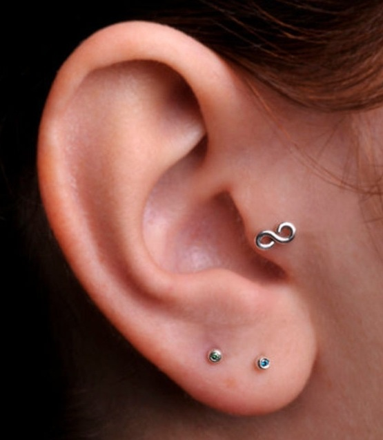 Infinity tragus piercing! Love! Need that earring! Good thing i have my tragus pierced!
