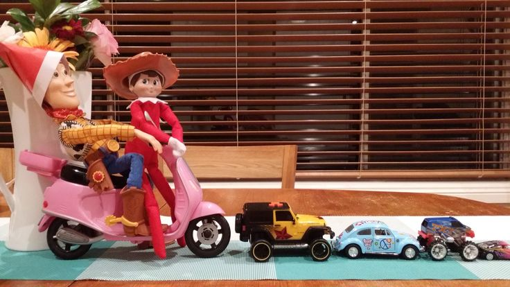 Elf on the shelf. Woody and Jingle Elf swap hats and get stuck in traffic
