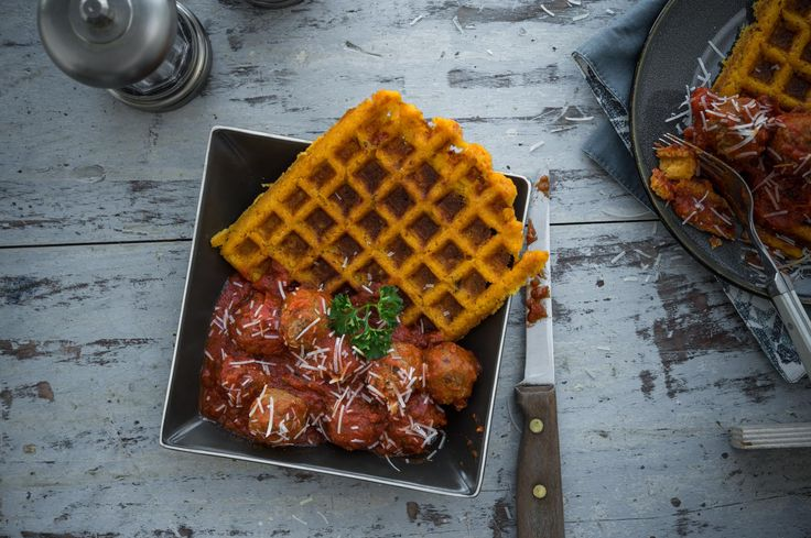 Whipped Goat Cheese and Polenta Waffles | Smooth and creamy is super easy with this polenta recipe! Whipped goat cheese adds richness and flavor to make these waffles a winner. Try them alongside fried chicken with maple syrup, or as a base for meatballs and tomato sauce!