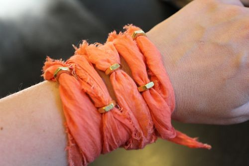 funky bracelet made from strips of bold fabric and hex nuts. I love bracelets, but they always seem outrageous for the little amount of material.  I must try this