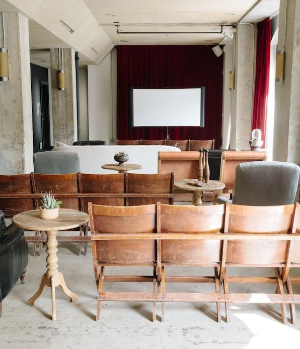 Harlin Auditorium Chairs at Found Vintage Rentals. Wooden auditorium chairs perfect for unique ceremony or conference seating. Each piece has four connected wooden seats.