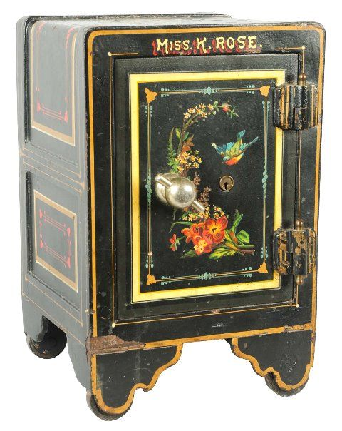March 30th Auction. From the Guy Zani Jr. Safe Collection: Salesman Sample of York Bankers Safe. Circa 1898. With open bolt work and key lock door. Bolt work and nickel plating and copper flashing finish. Original wood interior with drawer. Weighs approximately 48 pounds. #SalesmanSample #BankersSafe #GuyZani #MorphyAuctions