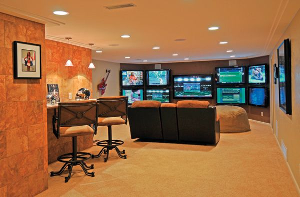 My husband's ultimate man cave (good for women like me who love football Sunday too!)