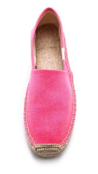 Neon pink espadrilles for summer.