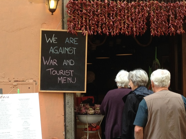 """sign on a ristorante in Trastavere, Rome. """"We are against War and Tourist Menu"""""""