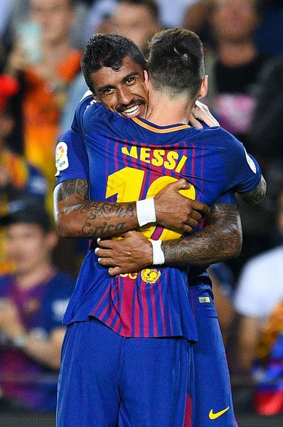 Paulinho of FC Barcelona celebrates with his team mate Lionel Messi after scoring his team's second goal during the La Liga match between Barcelona and SD Eibar at Camp Nou on September 19, 2017 in Barcelona.
