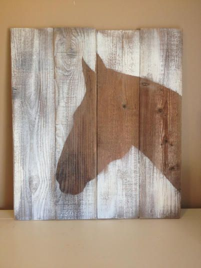 "This beautiful silhouette of a horse is handpainted on beautifully aged reclaimed lumber. This wood has been naturally distressed over the years. Dark stain with white. Original hand painted art.  Large picture 21.5"" x 24"""