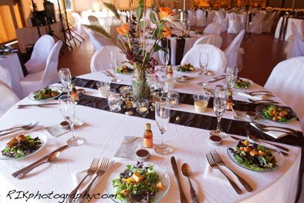 Centerpiece and table decorations at this Bluff Mountain Inn barn wedding. Click here for more from http://bluffmountaininn.com