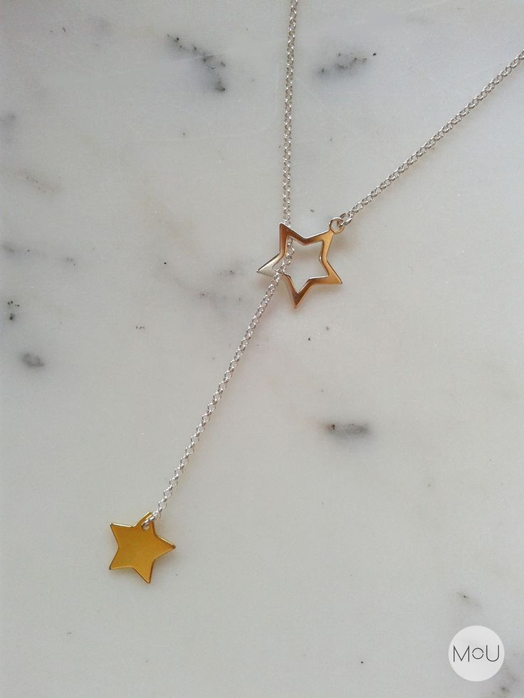 Intersperse stars necklace made entirely of sterling silver and with the lowest star gold-plated. All by MOU