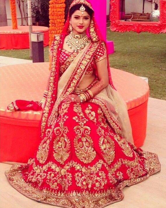 Indian bride wearing bridal lehenga and jewelry. #BridalHairstyle #BridalMakeup. Sabyasachi lehenga