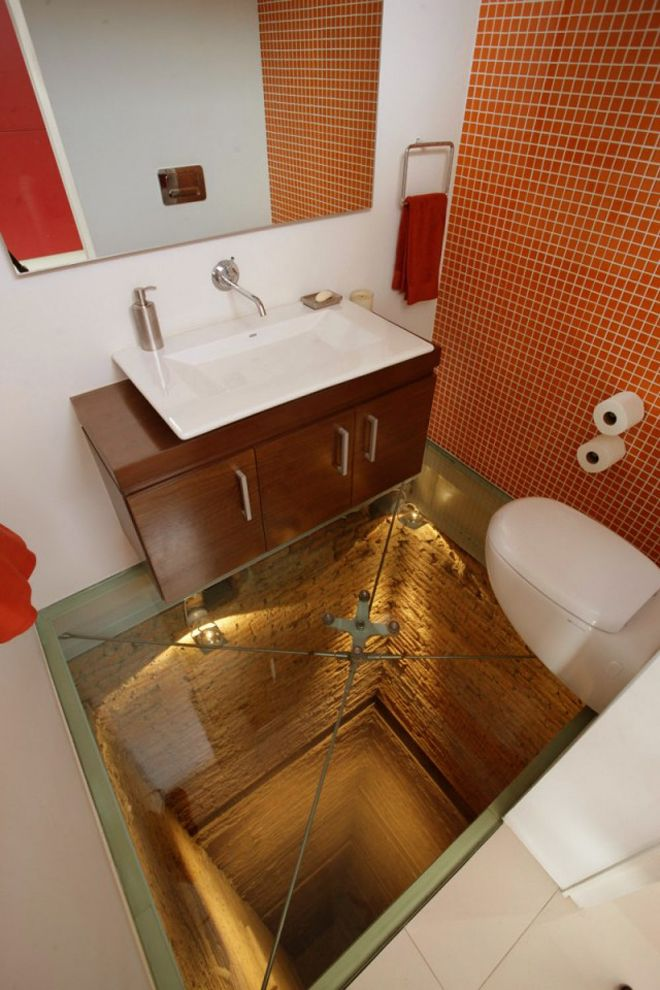 While designing the interior of a penthouse on the top of a 1970s Mexican colonian building in Mexico, Guadalajara-based architects Hernandez Silva Arquitectos decided to situate a bathroom on top of an unused 15-story elevator shaft, and leave the floor completely transparent.Bathroom Design, Powder Room, Ideas, Interiors, Bathroom Vanities, Toilets, Elevator Shaft, Glasses Floors, House
