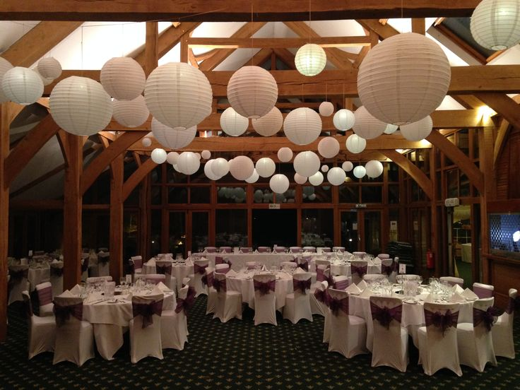 Our round paper lanterns soften this angular and powerful wooden venue. Use  light, neutral