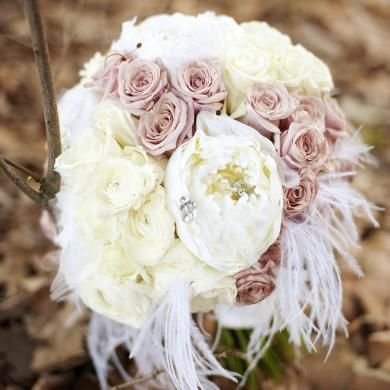 Beautiful rose and peony bouquet with feathers for a fairytale feel
