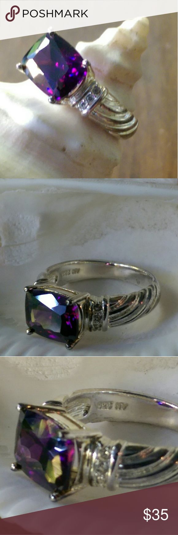 Vintage Avon  sterling silver amethyst ring size 8 Gorgeous ring.!! Sterling silver with amethyst  center and crystal accents . Size 8.  Never worn. Marked 925. Comes with original box.  Ring from year 2003. Original price unknown. Ring total wt 4 Grams. The box is crushed & tattered , but ring is perfect. We love this ring! Avon Jewelry Rings