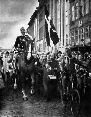 King Christian X of Denmark riding through Copenhagen.  The Royal Life Guards (Den Kongelige Livgarde) is an infantry regiment of the Danish Army, founded in 1658 by his father, King Frederik III. It serves in two roles: as a front line combat unit, and as a guard/ceremonial unit to the Danish monarchy.