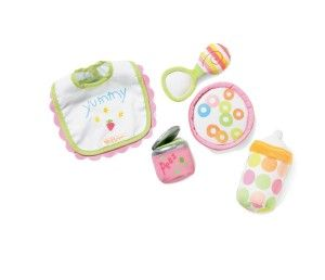 """Manhattan Toy Baby Stella Feeding Set Accessory for Nurturing Dolls Part of the Award Winning Baby Stella Doll Collection. Feeding play set includes a soft """"can"""" of peas and a soft cereal bowl. Also includes a bottle, spoon and bib that attach magnetically to any Baby Stella Doll's mouth. Encourages nurturing and role play. Doll not included' http://bit.ly/13qBfm6"""