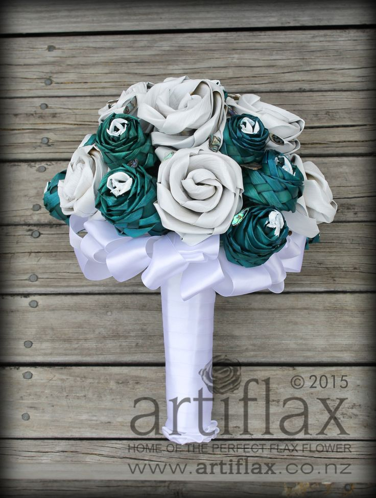 Flax Flower bridal bouquet by Artiflax  Turquoise and white flax flowers with paua shell pieces