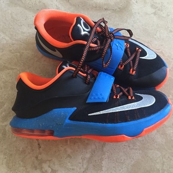 KD sneakers low tops size 4.5 big kids KD (Kevin Durant) sneakers. Low tops, size 4.5 for big kids. Black blue and orange. Pretty clean and good condition. Nike Shoes Sneakers