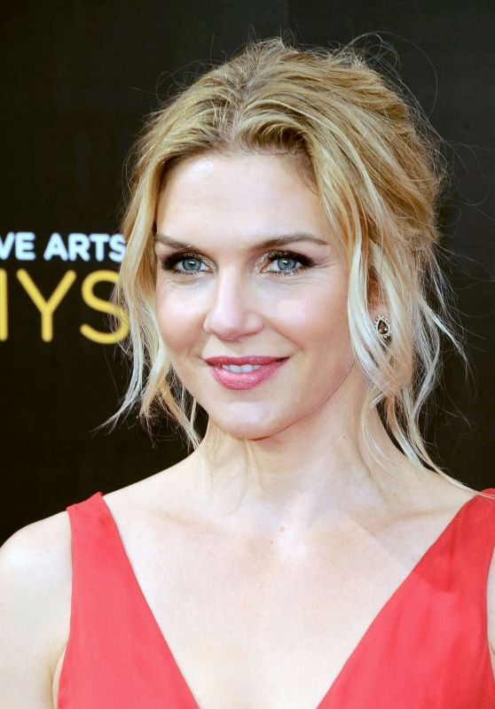 Rhea Seehorn (Better Call Saul) stunned in a red dress with Simon G's rose gold pieces including the bangle MB1593 and overlapping ring LR2021.