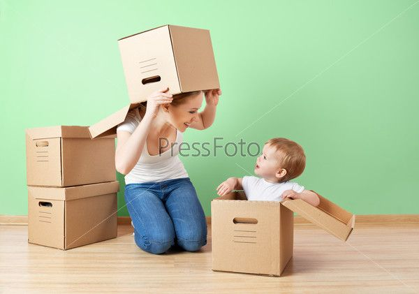 happy family mother and baby daughter in an empty apartment wit