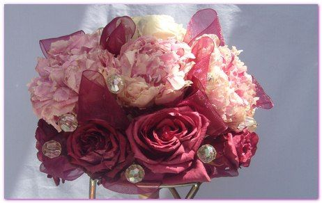 Peony Heads in an Arrangement with Roses